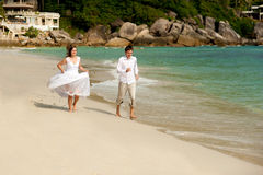 Happy and love on the beach Stock Photos
