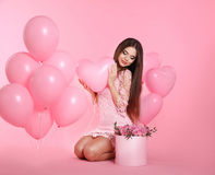 Happy love brunette girl with balloons and bouquet of rose flowe Stock Images