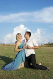 Happy love couple in the green field Royalty Free Stock Photo