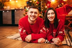 Love couple lies on the floor, christmas holidays royalty free stock photos