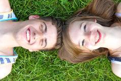 Happy love couple lying in the grass Royalty Free Stock Image