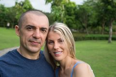Happy in love couple in the park together Royalty Free Stock Photography
