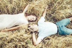 Happy in love couple relaxing on field Stock Image