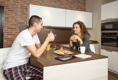 Happy love couple speaking at breakfast home Stock Photo