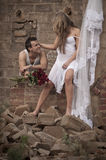 Happy in love couple standing together in old broken down building Royalty Free Stock Photo