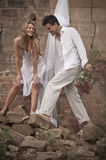 Happy in love couple standing together in old broken down building Royalty Free Stock Image