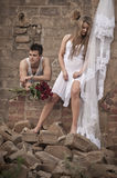 Happy in love couple standing together in old broken down building Stock Photography