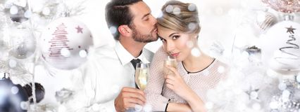 Happy couple toasts at christmas and new year Stock Images