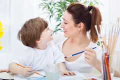 Happy love family painting and smiling together Stock Image