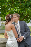 Happy in love newlyweds kissing tenderly Royalty Free Stock Image