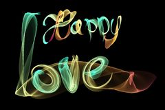 Happy Love vintage lettering written by fire or smoke over black background Stock Photo