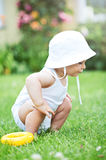Happy, lovely baby boy wearing white hat, playing outside - summer time Stock Photography