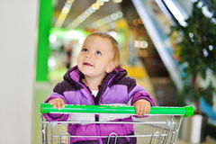 Baby in shop Royalty Free Stock Images