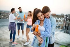 Happy lovely couple having fun time at party royalty free stock image