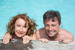 Happy and lovely couple in private swimming pool Royalty Free Stock Image