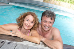 Happy and lovely couple in private swimming pool Royalty Free Stock Photo