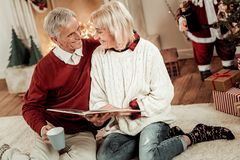 Happy lovely couple sitting and overlooking the album. stock photos