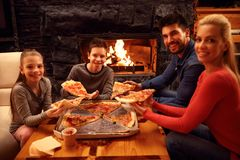 Happy family eating pizza Royalty Free Stock Photography