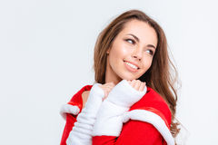 Happy lovely female in red santa claus costume. Pleased happy lovely young female in red santa claus costume over white background Royalty Free Stock Photography