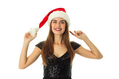 Happy lovely girl in santa hat. Looking and smiling on camera isolated on white background Royalty Free Stock Photo