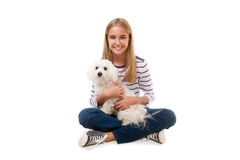 Happy lovely girl sitting on the floor with maltese dog on her knee,isolated. Over white background Stock Images