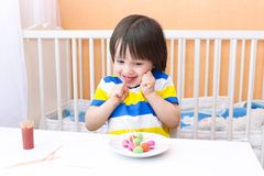 Happy lovely little boy with lollipops of playdough and toothpic Royalty Free Stock Image