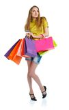 Happy lovely woman with shopping bags and credit card over white Stock Photography