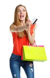 Happy lovely woman with shopping bags and credit card over white Royalty Free Stock Photo