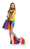 Happy lovely woman with shopping bags and credit card over white Royalty Free Stock Photos