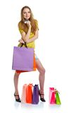 Happy lovely woman with shopping bags and credit card over white Royalty Free Stock Photography