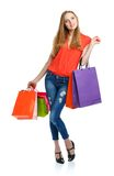 Happy lovely woman with shopping bags over white Stock Image
