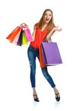 Happy lovely woman with shopping bags over white Royalty Free Stock Images