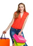 Happy lovely woman with shopping bags over white Stock Photos