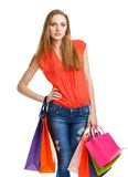Happy lovely woman with shopping bags over white Royalty Free Stock Photos