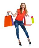 Happy lovely woman with shopping bags over white Stock Photography