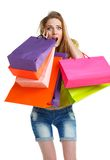 Happy lovely woman with shopping bags over white Stock Images