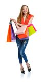 Happy lovely woman with shopping bags over white Royalty Free Stock Image