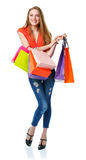 Happy lovely woman with shopping bags over white Royalty Free Stock Photo