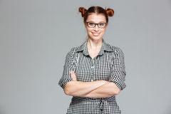 Happy lovely young woman in glasses standing with hands folded Royalty Free Stock Photos