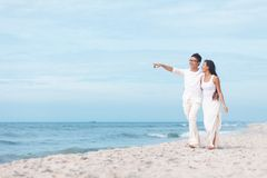 Happy lovers. Lovers walking by the sea Stock Photo