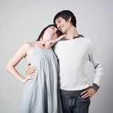 Happy lovers. Studio portrait of a young couple posing with a very happy expression on their faces Stock Images