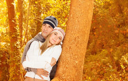 Happy lovers in autumn park Royalty Free Stock Images