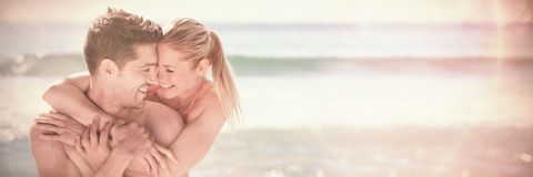 Happy lovers at the beach royalty free stock image