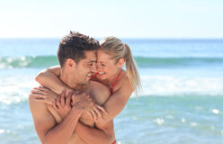 Happy lovers at the beach. Happy young lovers at the beach stock photography