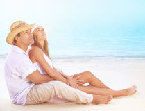 Happy lovers on the beach Stock Photography