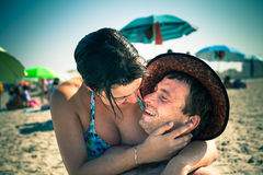 Happy lovers on the beach Stock Photo