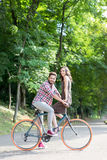Happy lovers enjoying the sunny weather by bike Stock Photo