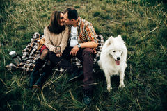 Happy lovers. Happy family enjoy cheerful time outdoors with dog Stock Image