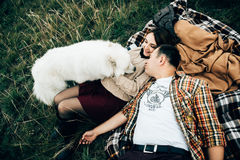 Happy lovers. Happy family enjoy cheerful time outdoors with dog Royalty Free Stock Image