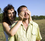 Happy lovers in field. Young couple in love having fun outdoors Royalty Free Stock Image